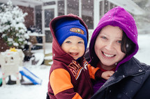 Mother and son in the snow