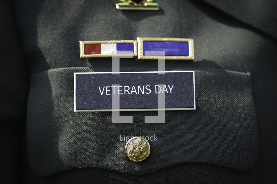 Veterans Day printed on the military name badge of uniform.
