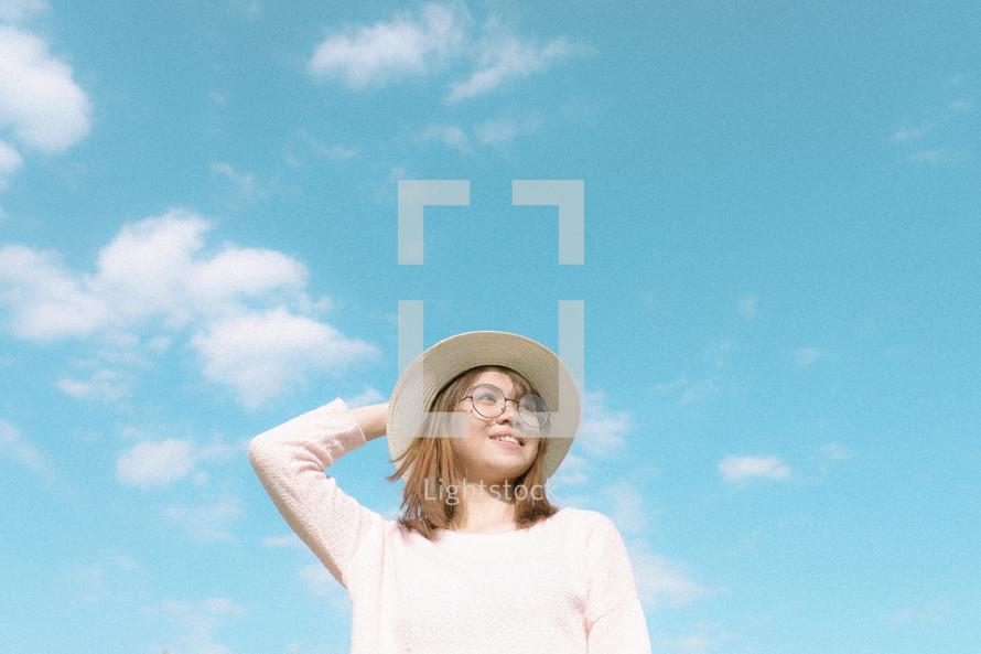 a woman wearing a hat