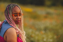 African-American woman in pink and blonde braids with staring eyes