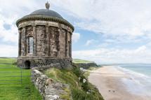 stone round building along an Irish coast