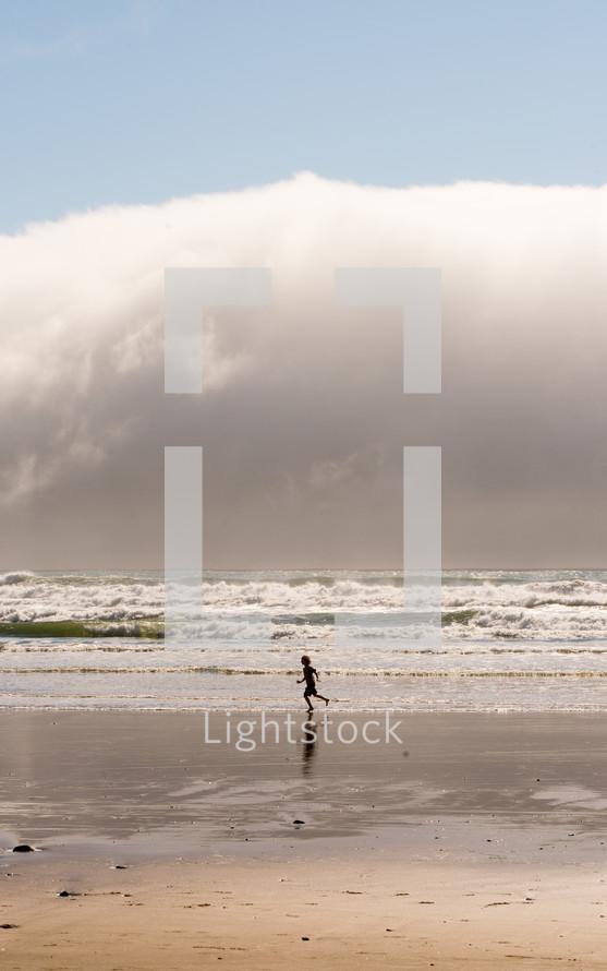 child running on a beach