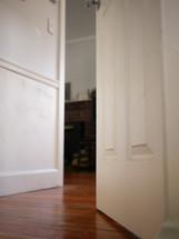 a cracked door to a bedroom