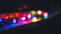 string lights on acoustic piano keys
