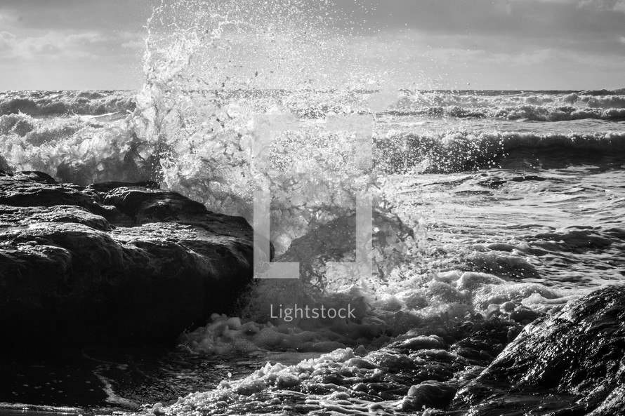 waves splashing onto rocks
