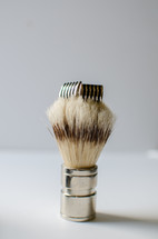 cuff links on a brush
