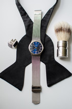 bowtie, watch, brush, and cuff links