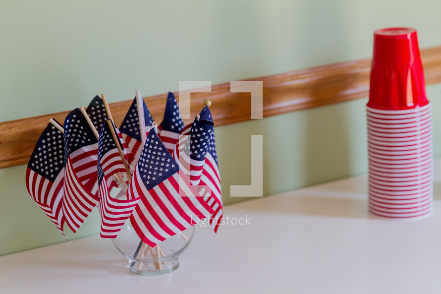 American flags in a vase and red solo cups