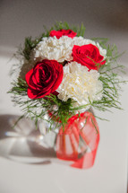 roses and carnations in a vase