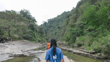 hiking on river rocks