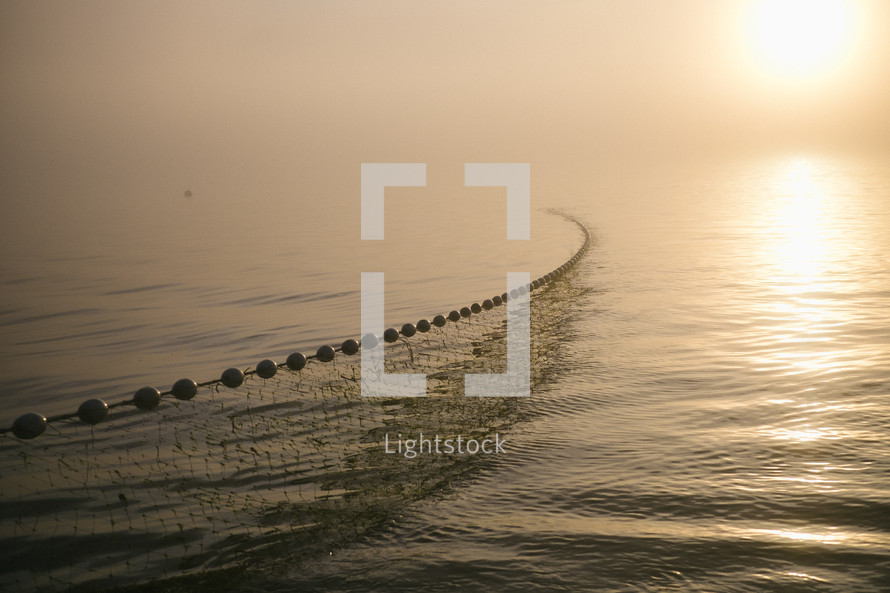 casting net over water