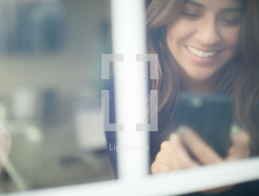 woman looking at a cellphone screen
