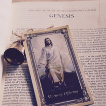 Morning Prayer card with a picture of Jesus and a bell on the pages of a Bible