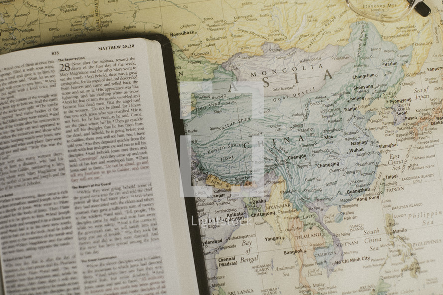 Bible on a map of Asia