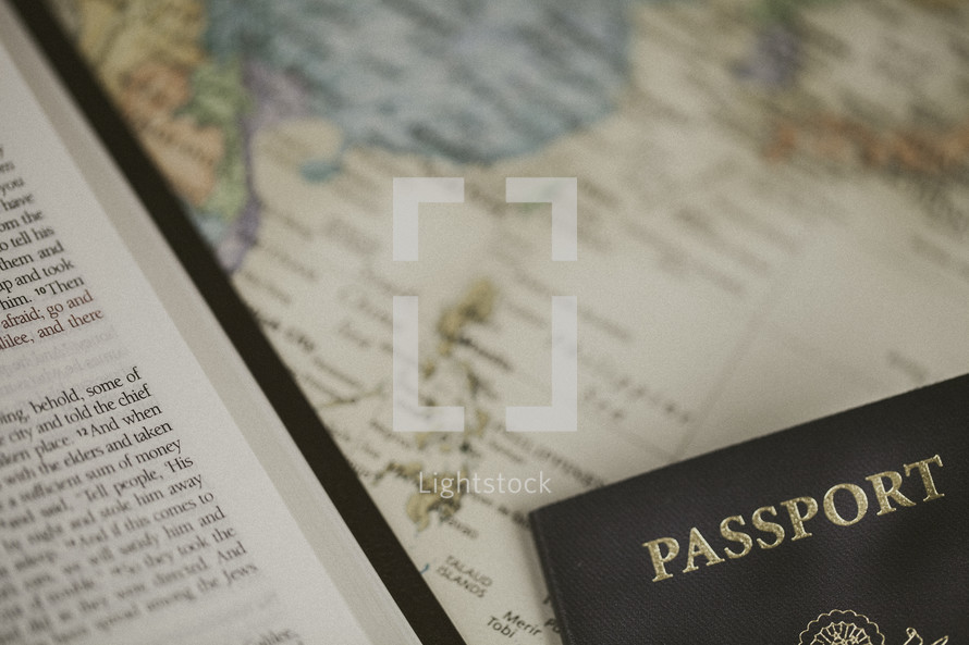 Bible and passport on a world map, missions preparation
