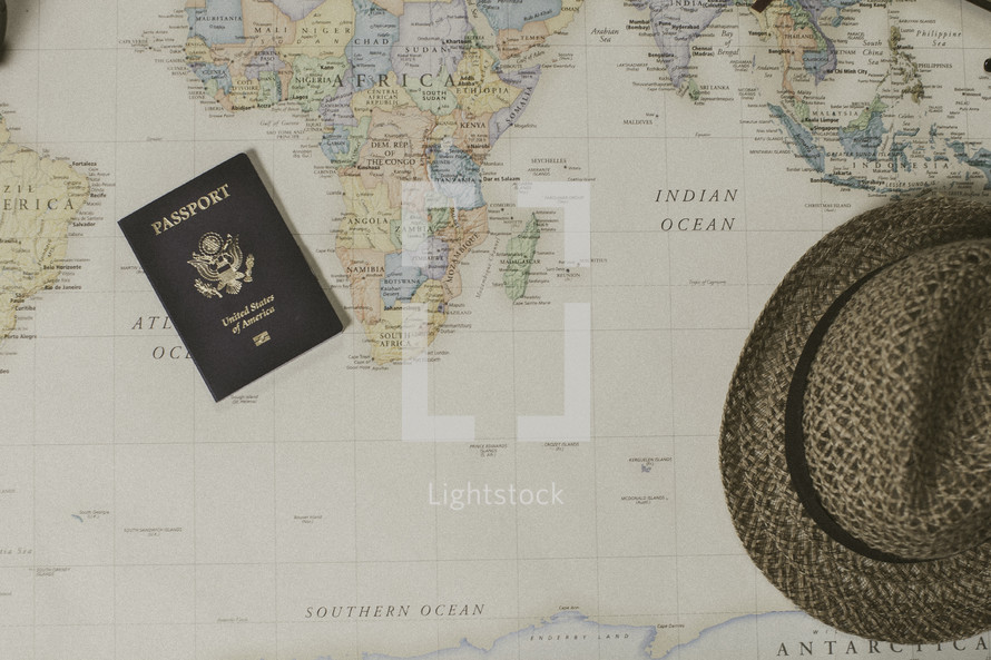passport and hat on a map, missions preparation