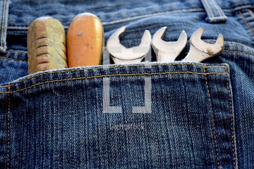 tools in a denim pocket