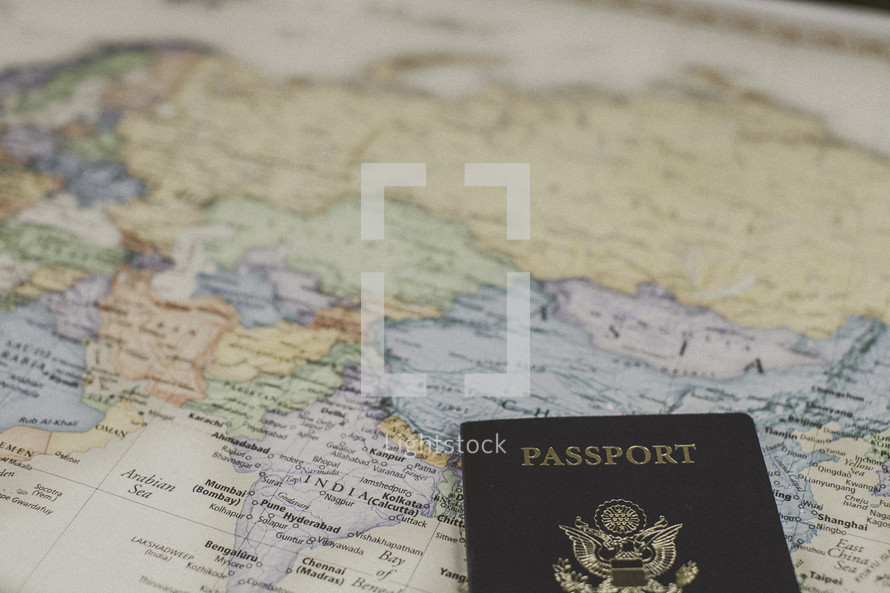 passport on the map of Asia