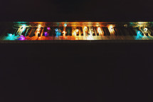 string lights on acoustic piano with copyspace