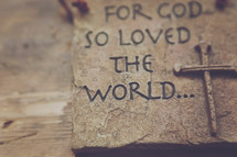 "A plaque reading, ""For God so loved the world."""
