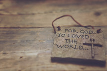 """A plaque reading, """"For God so loved the world."""""""