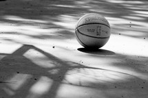 basketball and a shadow of a basketball net