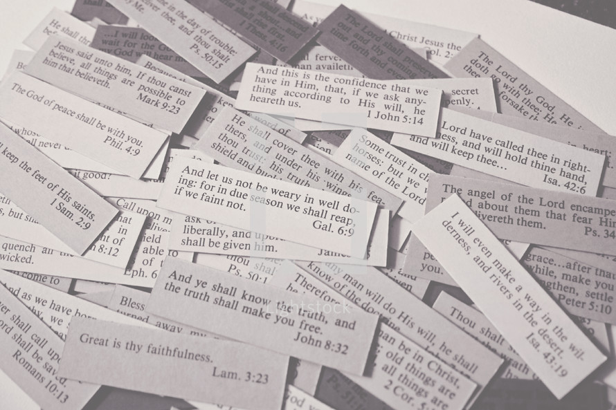 Scripture cards laying on a table in black & white.  Bible verses up close covering perseverance, the truth and God's faithfulness from Galatians, John, Lamentations, Isaiah and more.