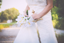 a bride holding a flowers and a sword