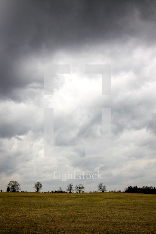 cloudy sky over a field
