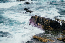 Ocean waves crashing upon a rocky shore.