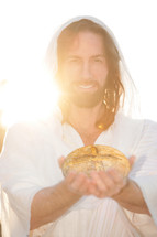 Jesus holding a loaf of bread.