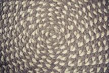 gray and white circular rug
