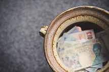pot of European currency, cash