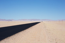 A black road through a barren landscape.