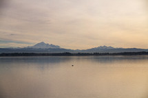 distant snow capped mountains across a lake