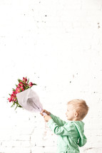 boy holding a bouquet of flowers