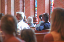 parishioners sitting in church pews at a Lutheran church