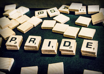 word pride in scrabble pieces