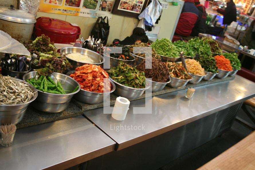 vegetables in bowls in a restaurant in Korea