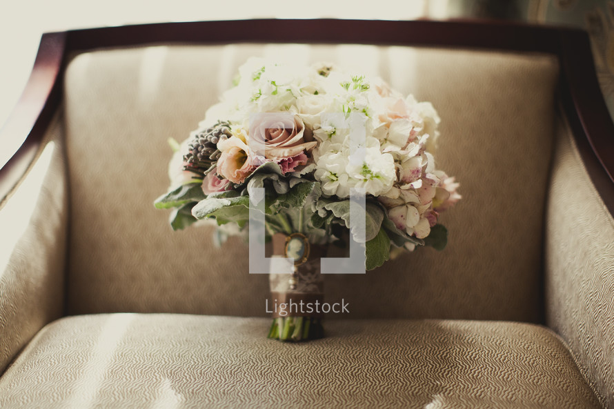A bouquet of flowers sitting in a chair