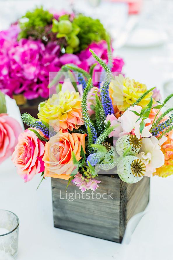 Flower arrangements as centerpieces colorful wood box
