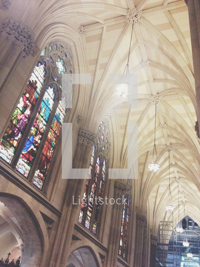 stained glass windows and arched ceiling in a cathedral