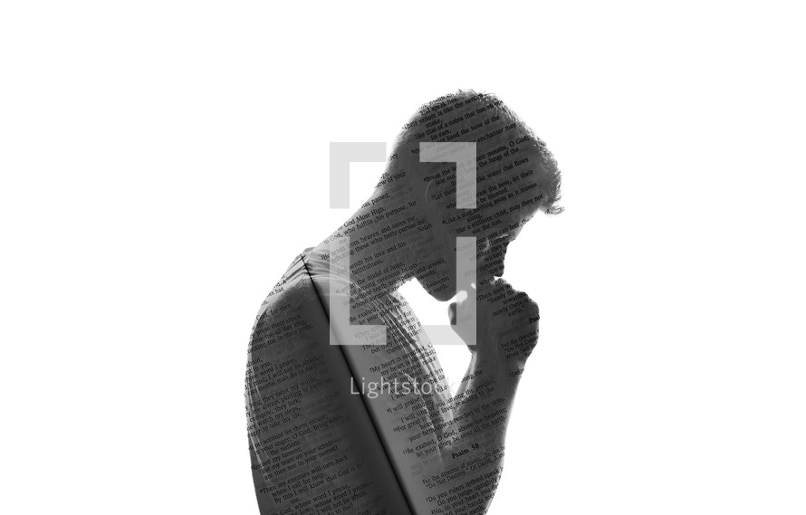 silhouette of a man in prayer with Bible pages overlapping