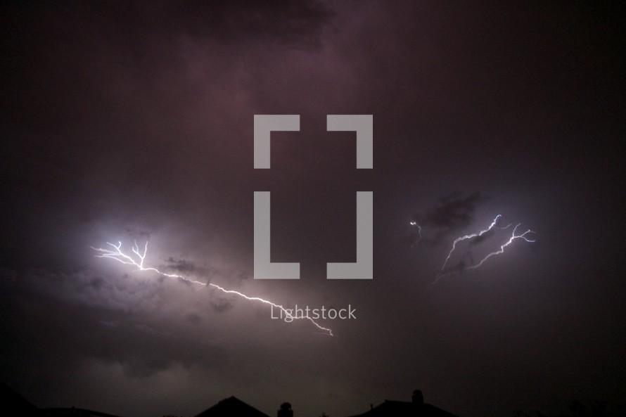 Lightening strikes in the night sky