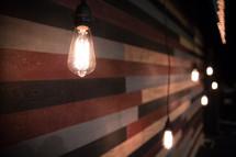 hanging lightbulbs on stage