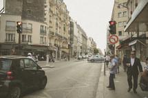 people walking on a city sidewalk in Paris