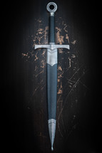 Sword on a grunge background with scratches