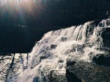 A sunlit waterfall.