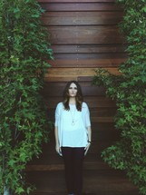 woman standing in front of a wood wall