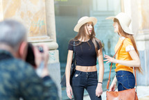Photographer during a shooting in Naples with two models.